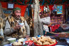 Kazakh family of hunters with hunting birds golden eagles inside the mongolian Yurt. Royalty Free Stock Photo