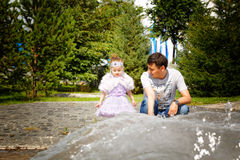 Kazakh father with daughter. Son and daughter in the summer park Royalty Free Stock Photos