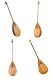Kazakh folk musical instrument dombra isolated on white background. Kazakh national musical instrument dombra, a group of four tools isolated on white background Royalty Free Stock Image