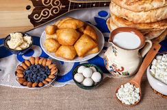 Kazakh food. Asian dishes and Dombra Kazakh instrument on the table Royalty Free Stock Photos