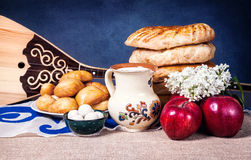 Kazakh food and dombra instument. Asian dishes and Dombra Kazakh instrument in yurta Stock Image