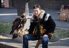 Kazakh man with falcon Stock Image
