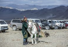 Kazakh man in traditional outfit with his horse stock images