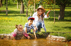 Kazakh mother with children. Son and daughter in the summer park Royalty Free Stock Photo