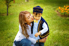Kazakh mother with children. Son and daughter in the summer park Stock Images