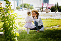 Kazakh mother with children. Son and daughter in the summer park Stock Image