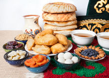 Kazakh national food. On the table with national hat and tea at white background Stock Images