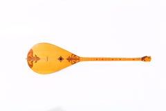 Kazakh national instrument dombra and taikazan. On white background Stock Photography