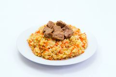 Kazakh plov. Kazakh national meal plov on a plate on white background Royalty Free Stock Photos