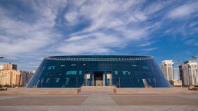 Kazakh National University of Arts timelapse hyperlapse. Astana, Kazakhstan. Blue cloudy sky at summer day stock video footage