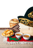 Kazakh tradition. Asian dishes, tea and Dombra Kazakh instrument on the table with oriental carpet Stock Photos