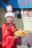 Kazakh women holding baursaks Royalty Free Stock Images