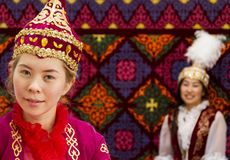 Local women and man in traditional clothes at national folkloric games in Almaty, Kazakhstan. stock photo