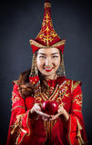 Kazakh women with red apple Stock Photography