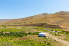 Kazakh yurt in Assy plateau in Tien-Shan mountain  in Almaty, Kazakhstan,Asia at summer. Nature of  green trees Stock Photo