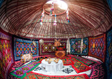 Kazakh yurt interior. Ethnic nomadic house yurt interior with table of national food at Nauryz celebration Royalty Free Stock Photos