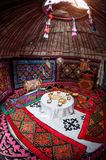 Kazakh yurt interior. Ethnic nomadic house yurt interior with table of national food at Nauryz celebration Stock Image