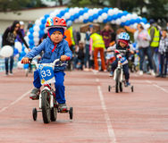 KAZAKHSTAN, ALMATY - JUNE 11, 2017: Children`s cycling competitions Tour de kids. Children aged 2 to 7 years compete in Stock Images