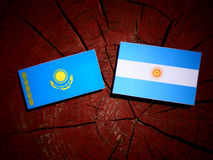 Kazakhstan flag with Argentinian flag on a tree stump  Stock Image