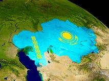 Kazakhstan with flag on Earth Stock Photo