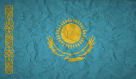 Kazakhstan flag with the effect of crumpled paper and grunge Stock Images