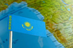 Kazakhstan flag with a globe map as a background Royalty Free Stock Images