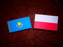 Kazakhstan flag with Polish flag on a tree stump isolated. Kazakhstan flag with Polish flag on a tree stump vector illustration