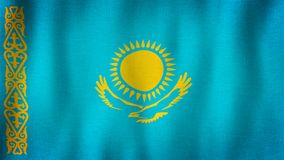 Kazakhstan flag waving in the wind. Closeup of realistic Kazakh flag with highly detailed fabric texture