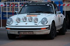 Kazakhstan, Kostanay, 2019-06-20, The 7th Peking to Paris Rally Motor Challenge. A retro white car Porsche is parked near a fence. Kazakhstan, Kostanay, 2019-06 stock photography