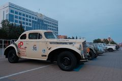 Kazakhstan, Kostanay, 19-06-19, Vintage cars stand in a row in the town square. Evening light. The Greatest Motoring Adventure - royalty free stock photography