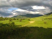 Kazakhstan Landskape. Roud in Djungaria area, far away from popular travel path in Kazakhstan, mauntain, clouds, roud, filed Royalty Free Stock Images