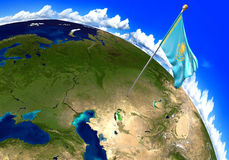 Kazakhstan national flag marking the country location on world map. 3D rendering, parts of this image furnished by NASA Royalty Free Stock Photography