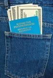 Kazakhstan passport and dollar bills Stock Photography