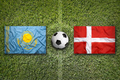Kazakhstan vs. Denmark flags on soccer field Stock Photo