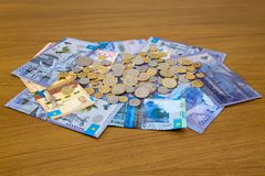 Kazakhstani tenge monety i banknoty Obrazy Stock