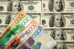 Kazakhtenge och U S Dollar Arkivbild