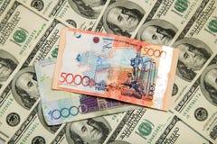 Kazakhtenge och U S Dollar Arkivfoton