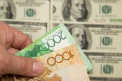 Kazakhtenge och U S Dollar Royaltyfria Bilder