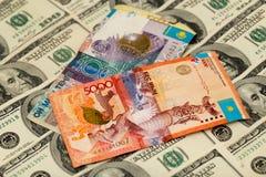 Kazakhtenge och U S Dollar Fotografering för Bildbyråer
