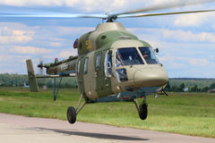 Kazan Ansat-U helicopter takes off at Kubinka air force base during Army-2015 forum. KUBINKA, MOSCOW REGION, RUSSIA - JUNE 18, 2015: Kazan Ansat-U helicopter Royalty Free Stock Image
