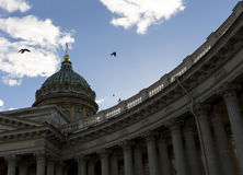 Kazan Cathedral in SaintPetersburg, blue sky, clouds, doves fly, Stock Image