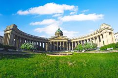 Kazan Cathedral with white clouds in the sky, grass meadow in Saint Petersburg summer lilac. Wide angle view, panorama. Kazan Cathedral with white clouds in the Royalty Free Stock Photos