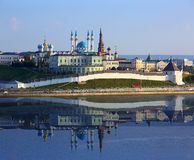 Kazan kremlin with reflection in river at sunset Stock Photos