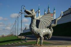 KAZAN, REPUBLIC TATARSTAN, RUSSIA - May, 2014: Metal sculpture. Of Zilant, the official symbol of Kazan, on the background of the Kazan Kremlin Kul Sharif royalty free stock photography