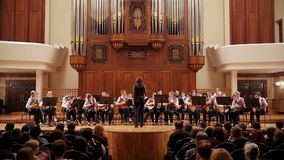 Kazan, Russia - april 15, 2017: Saydashev State Great Concert Hall - great children`s string orchestra on scene. Wide angle