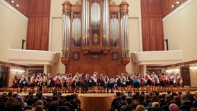 Kazan, Russia - april 15, 2017: Saydashev State Great Concert Hall - performing great children`s folk choir. Wide angle