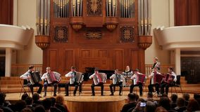 Kazan, Russia - april 15, 2017: Saydashev State Great Concert Hall - performing orchestra of accordionists - children. Teens on scene, wide angle