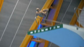 KAZAN, RUSSIA - 27 april 2015: 16th FINA World Championships. Male jump during competitions in a pool. KAZAN, RUSSIA - 27 april 2015: 16th FINA World stock video footage