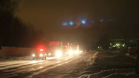 KAZAN, RUSSIA - DECEMBER 23, 2012: Festive Christmas caravan of Coca-Cola trucks driving on city night streets. Snow winter