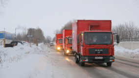 KAZAN, RUSSIA - DECEMBER 23, 2012: Festive Christmas caravan of Coca-Cola trucks driving on city snow streets. Winter day